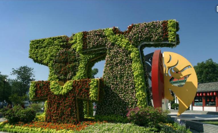 陜西銅川創意道路綠雕飛機造型的仿真綠雕定制