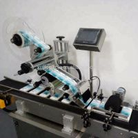全自动平牙线盒平面贴标签 旭亦节自动化设备