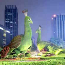 四川大量定制出售仿真植物绿雕造型 假草坪雕塑厂家供应公司哦